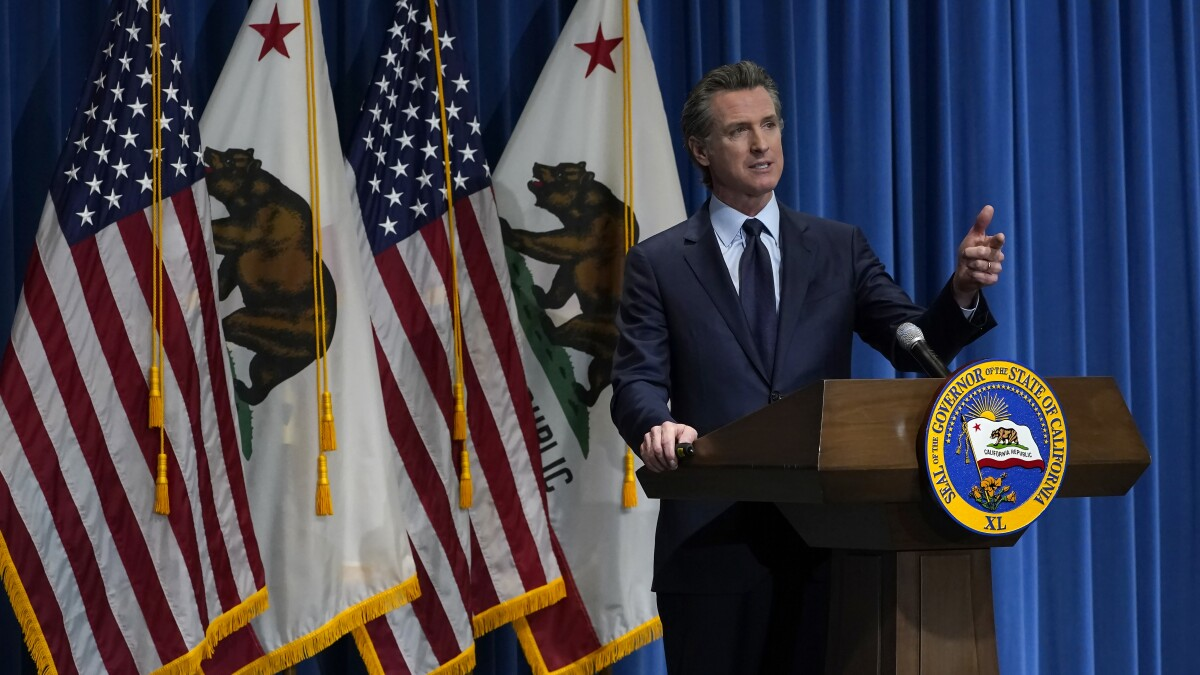 California Gov. Gavin Newsom outlines his 2021-2022 state budget proposal during a news conference in Sacramento, Calif., Friday, Jan. 8, 2021. (AP Photo/Rich Pedroncelli, Pool)