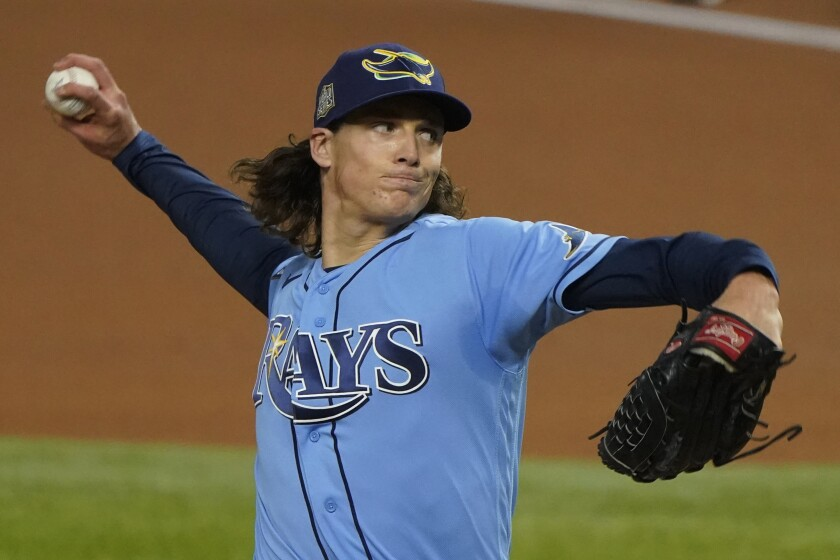 Tampa Bay Rays starting pitcher Tyler Glasnow throws against the Los Angeles Dodgers during the first inning in Game 5 of the baseball World Series Sunday, Oct. 25, 2020, in Arlington, Texas. (AP Photo/Tony Gutierrez)