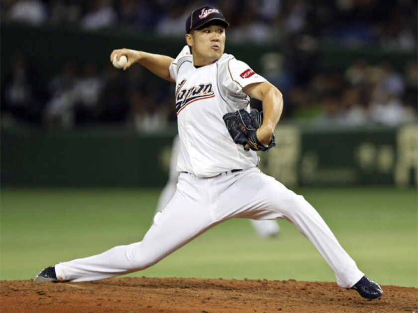 Japan's Masahiro Tanaka pitches against the Netherlands in the World Baseball Classic last March in Tokyo.