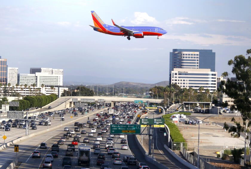 A Southwest Airlines plane flies over the 405 Freeway.