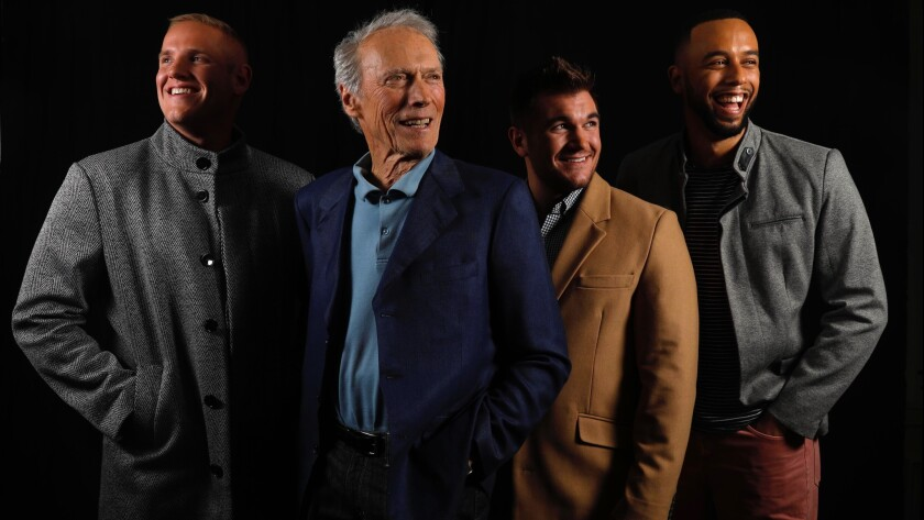 """Clint Eastwood, second from left, with Spencer Stone, from left, Alek Skarlatos and Anthony Sadler, who play themselves in the movie """"The 15:17 to Paris."""""""