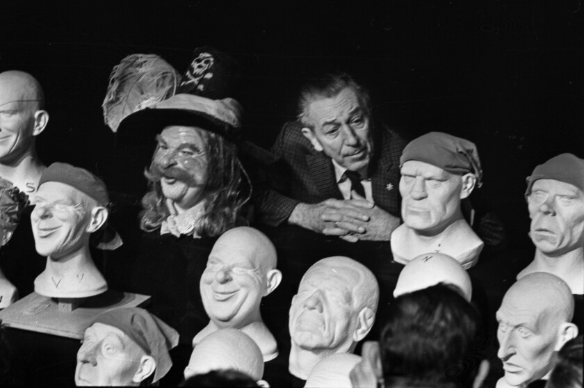 Feb. 3, 1966: Walt Disney with some of the plastic heads for the Pirates of the Caribbean ride that would later open at Disneyland.