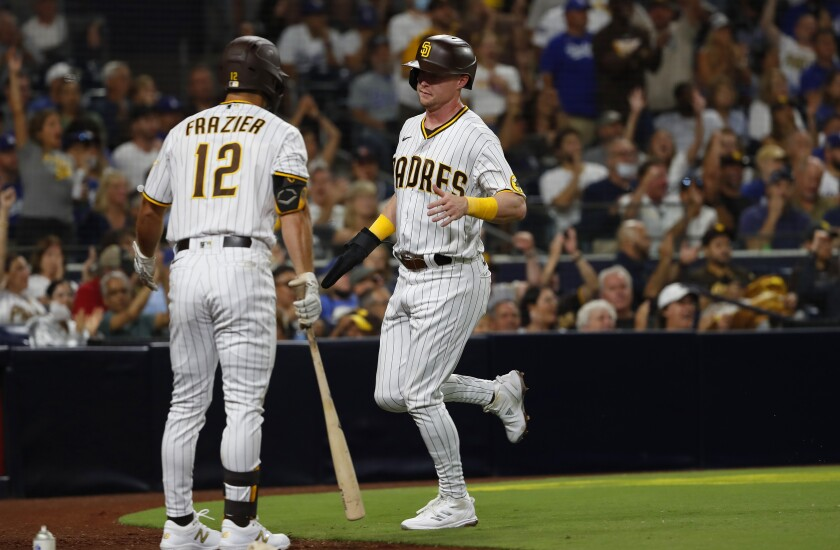 Jake Cronenworth, shown scoring the first run of Wednesday's game against the Dodgers at Petco Park.