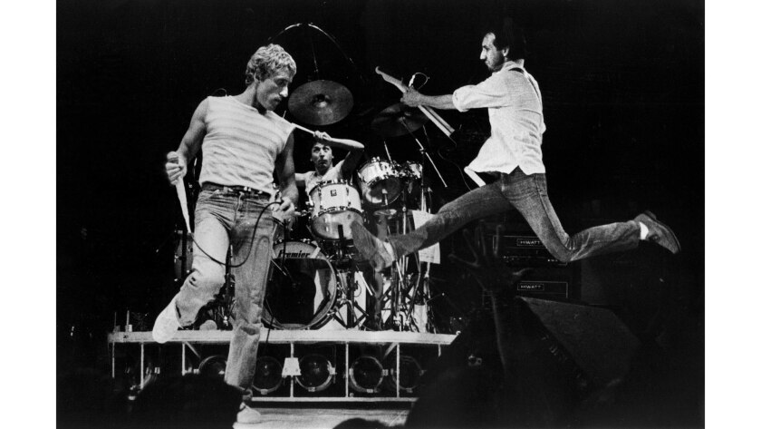 June 24, 1980: Singer Roger Daltrey, left, drummer Kenney Jones and guitarist Pete Townshend of the Who perform at the Los Angeles Sports Arena.