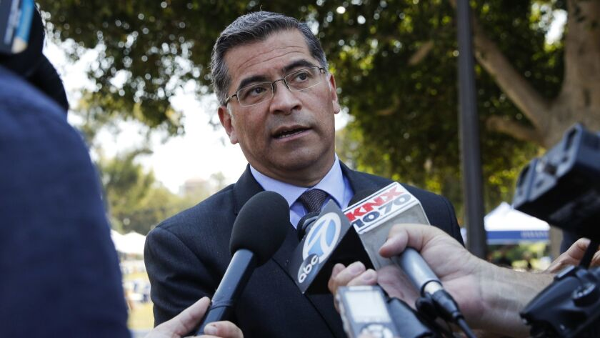 California Atty. Gen. Xavier Becerra, shown in August, agreed Friday to put the state's new net neutrality law on hold until after a decision by a federal appeals court on whether the Trump administration acted lawfully in ending regulation of internet providers.