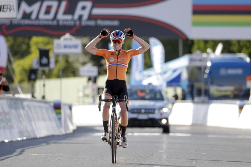 Netherlands' Anna van der Breggen celebrates winning the women's elite event, at the road cycling World Championships, in Imola, Italy, Saturday, Sept. 26, 2020. (AP Photo/Andrew Medichini)