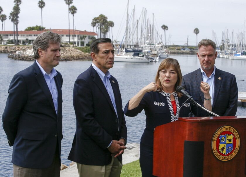 Reps. Mike Turner, left, Darrell Issa, Loretta Sanchez and Scott Peters hold a news conference in Oceanside.