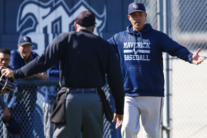 La Costa Canyon head coach Justin Machado argues with the home plate umpire during their game against Madison.