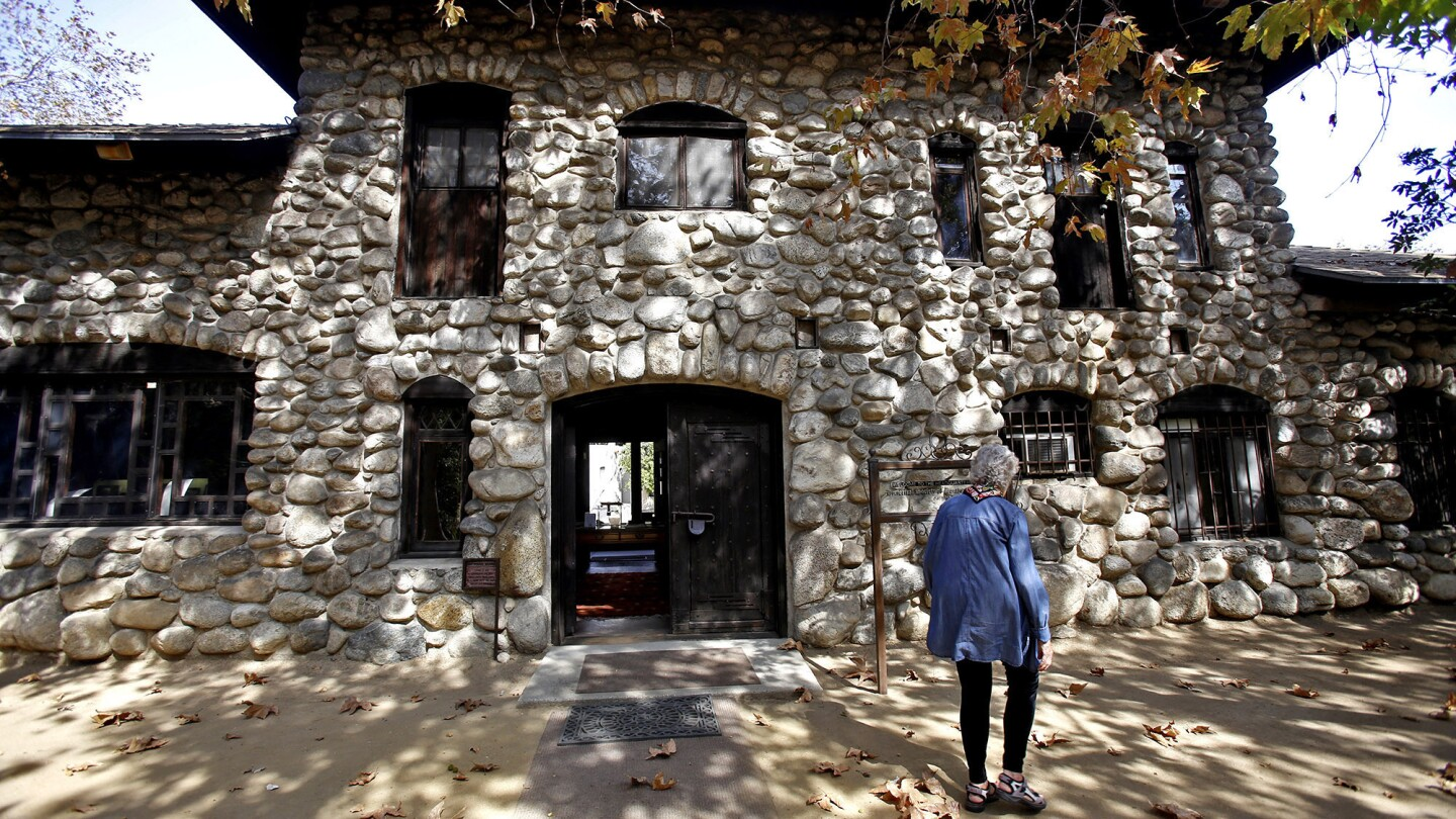 Executive Director Patricia Adler-Ingram of the Historical Society of Southern California walks outside the historic Lummis House.