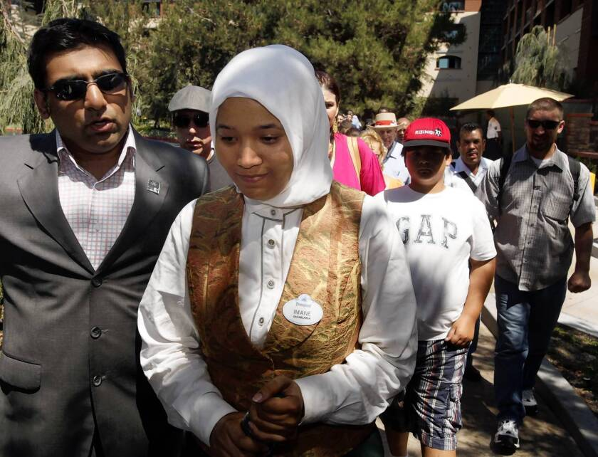 """Imane Boudlal worked as a hostess at the Storyteller's Restaurant in Disneyland's Grand Californian Hotel. She filed a complaint with the U.S. Equal Employment Opportunity Commission in 2010 and received a """"notice of right-to-sue"""" from the agency Aug. 8, opening the door for litigation."""