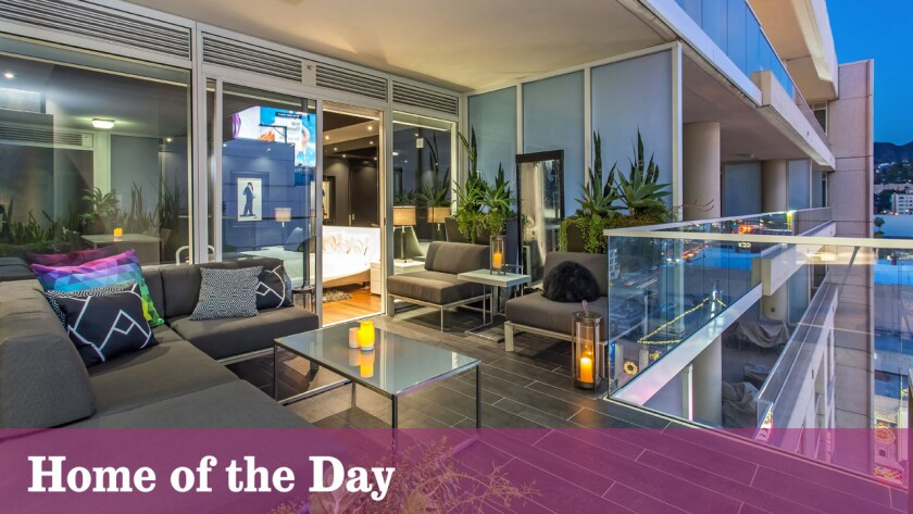 A balcony extends the living space outdoors at the penthouse in Hollywood.