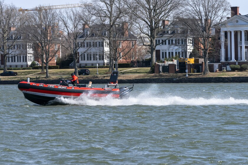 District of Columbia Fire Boat checks buoys in the waterway next to Fort McNair