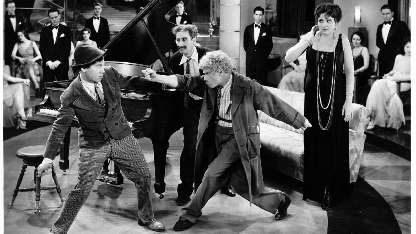 "Chico Marx, Groucho Marx, Harpo Marx and Margaret Dumont in ""Animal Crackers"""