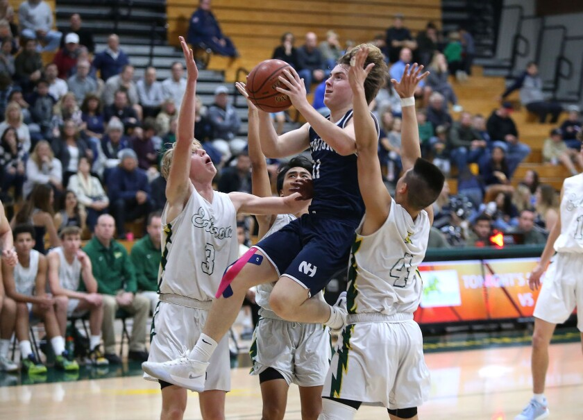 Newport Harbor's Levi Darrow, shown driving against Edison in 2020, had 22 points for the Sailors in their win.