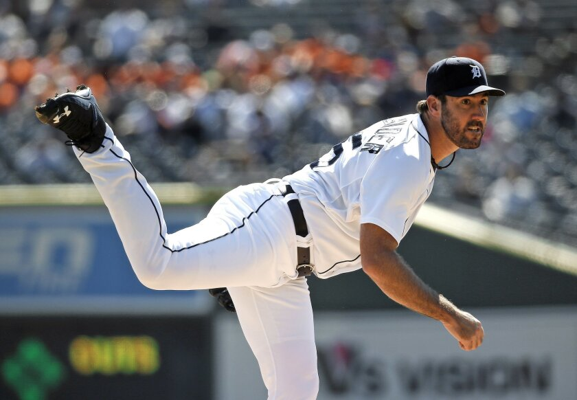 Detroit Tigers pitcher Justin Verlander follows through with a pitch against the Chicago White Sox in the first inning of a baseball game in Detroit, Wednesday, Sept. 23, 2015. (AP Photo/Paul Sancya)