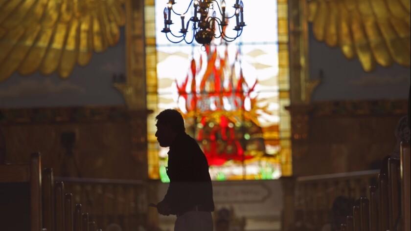 EAST LOS ANGELES, CA - JUNE 5, 2019 - - A congregant walks across the aisle during a prayer service