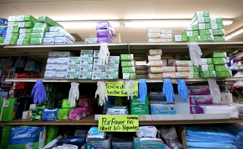 A Glendale store stocked with gloves and masks on South Verdugo Road. The city's cases of the novel coronavirus, now at 76, have been rapidly rising since the city reported its first infected patient on March 16.