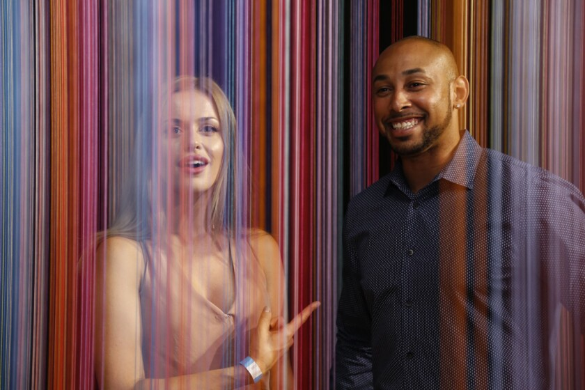 Blind daters Sarah Sharples and Jonathan Alvarado have a little fun in the art installation called Sweet Spot at Wonderspaces in Mission Valley.
