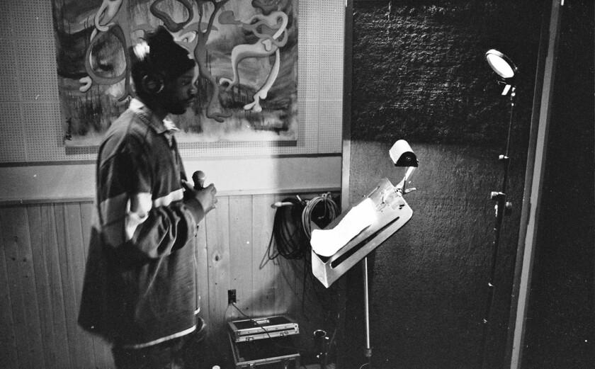 Malik B in a studio