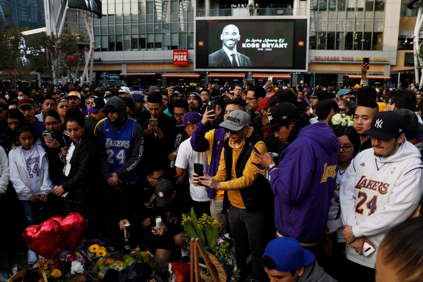 Fans outside Staples Center mourn Kobe Bryant, and daughter Gianna who were among nine killed in a helicopter crash in Calabasas on Jan. 26.