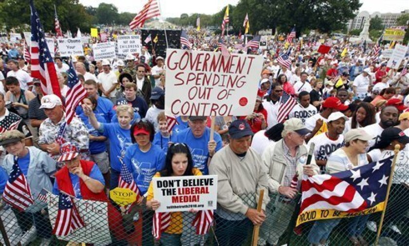 "People gather at the Capitol for a ""Remember in November"" rally to express opposition to government spending, particularly bailouts and economic policies backed by President Obama and Democrats in Congress, in Washington, Sunday, Sept. 12, 2010.  (AP Photo/J. Scott Applewhite)"
