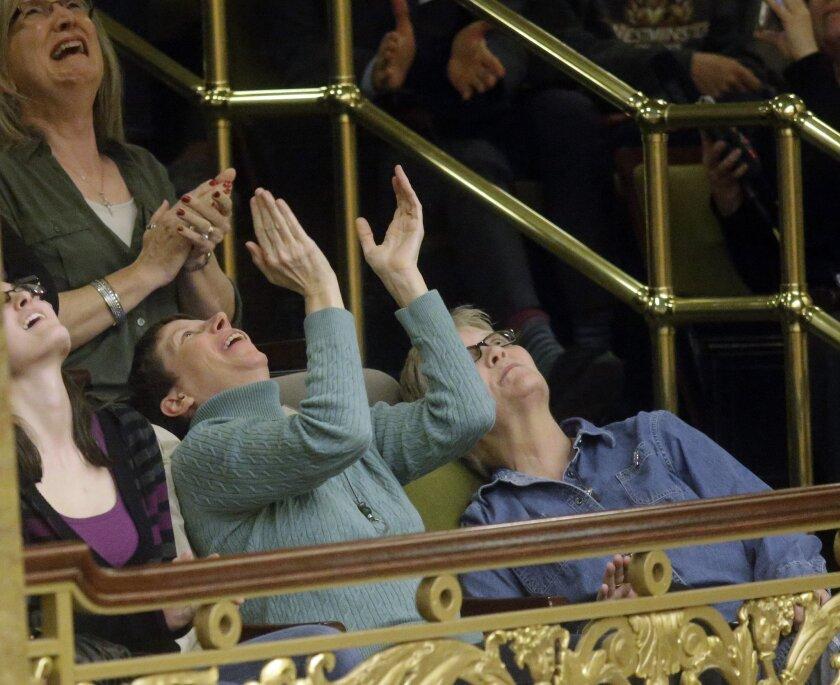 Kody Partridge and her wife celebrate after the Republican-controlled Utah Legislature passes an anti-discrimination bill.