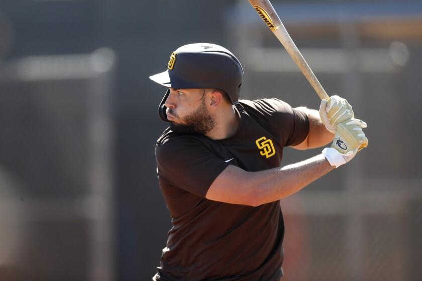 Eric Hosmer bats during a Padres spring training workout