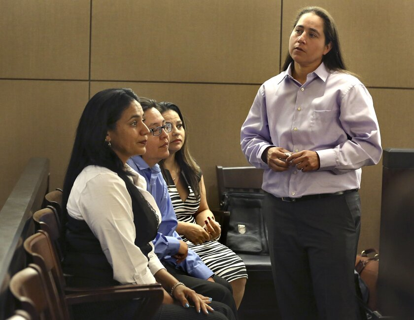 FILE - In this April 22, 2015, file photo, the four San Antonio women known as the San Antonio 4, from right, Anna Vasquez Elizabeth Ramirez, Kristie Mayhugh and Cassandra Rivera appear at a hearing in San Antonio, Texas. Texas District Judge Pat Priest said on Tuesday, Feb. 23, 2016 the four women were wrongfully convicted of sexually assaulting two young girls in a case that criminal justice advocates have long championed, and ordered a new trial. (Bob Owen/The San Antonio Express-News via AP File) RUMBO DE SAN ANTONIO OUT; NO SALES; MANDATORY CREDIT