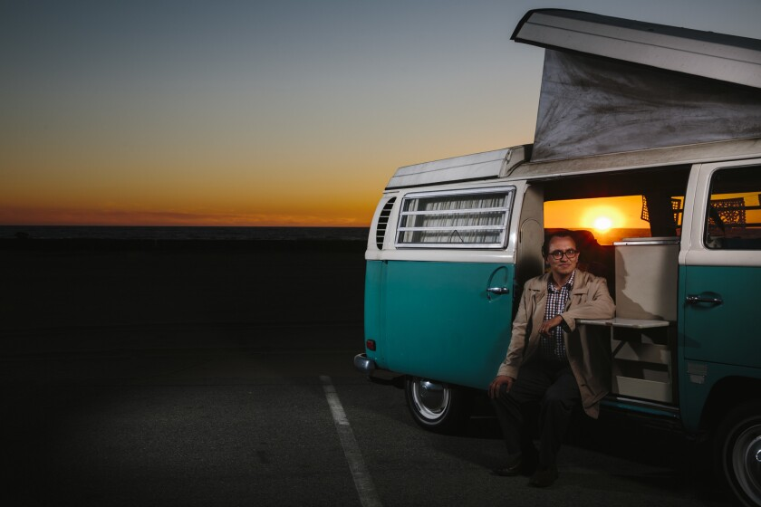 EL SEGUNDO, CALIF. - MARCH 13: LA Times writer Gustavo Arellano poses for a portrait with his Volksw