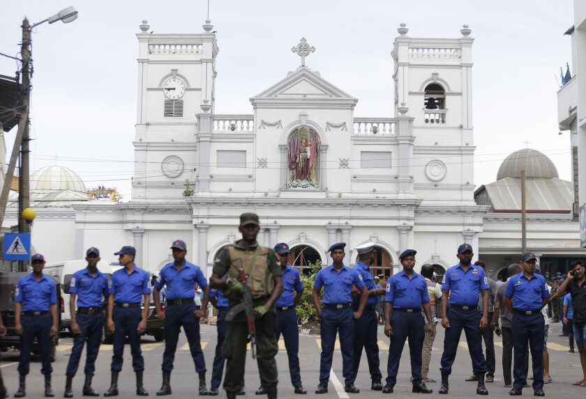 Sri Lankan soldiers secure the area around St. Anthony's Shrine after an explosion in Colombo on April 21.