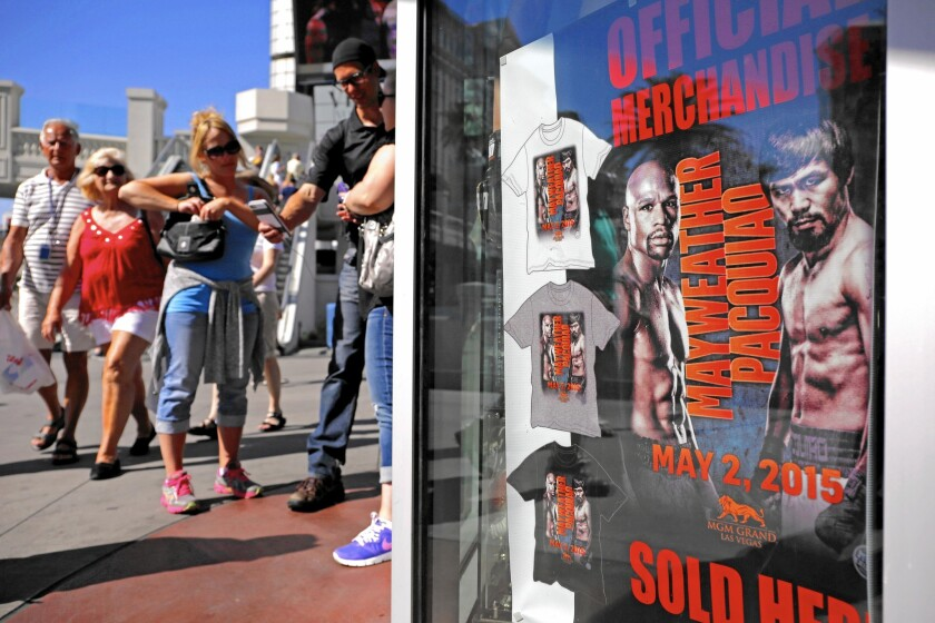 A store on the Las Vegas Strip advertises merchandise for the fight between Floyd Mayweather Jr. and Manny Pacquiao on Saturday at the MGM Grand.