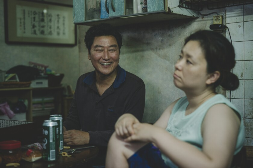 "Song Kang Ho and Jang Hye Jin in ""Parasite."""