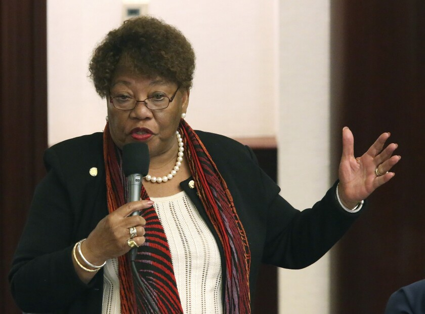 """FILE- In this April 17, 2019, file photo, Rep. Geraldine Thompson, D-Windermere, debates a bill during session in Tallahassee, Fla. Thompson is challenging the appointment of a Black woman to the Florida Supreme Court contending on Thursday, Sept. 10, 2020, that Republican Gov. Ron DeSantis is engaging in """"racial tokenism"""" by choosing someone the court itself has already ruled is not eligible for the position. (AP Photo/Steve Cannon, File)"""