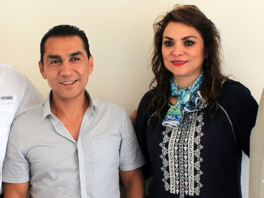 Iguala Mayor Jose Luis Abarca and his wife, Maria de Los Angeles Pineda, attend an event at the Municipal Palace in Iguala, Mexico on July 3.