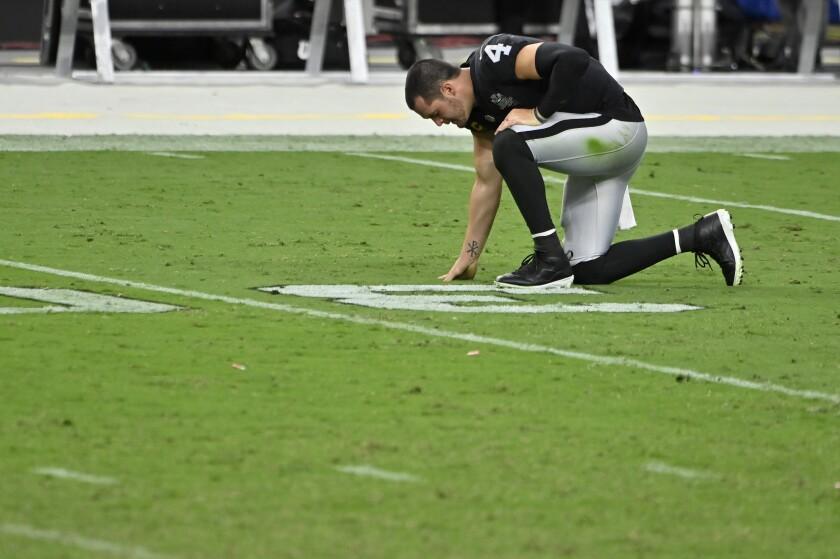 Las Vegas Raiders quarterback Derek Carr (4) kneels on the field after losing to the Buffalo Bills in an NFL football game, Sunday, Oct. 4, 2020, in Las Vegas. (AP Photo/David Becker)