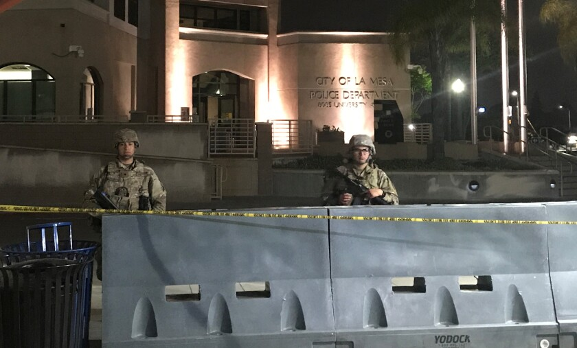 National Guard troops stand watch June 3 outside La Mesa Police Department headquarters.