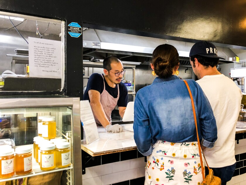 Chef and co-owner Kwang Uh assists customers at Baroo Canteen, which closed in December.