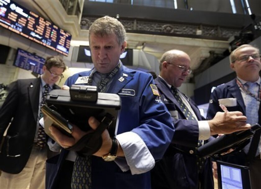 FILE - In this Wednesday, July 31, 2013, file photo, Richard Newman, second left, works with fellow traders on the floor of the New York Stock Exchange. Stock futures bounced from earlier lows Tuesday, Aug. 6, 2013, after the U.S. reported record exports in June and new data was released showing that home prices are rising sharply. (AP Photo/Richard Drew)