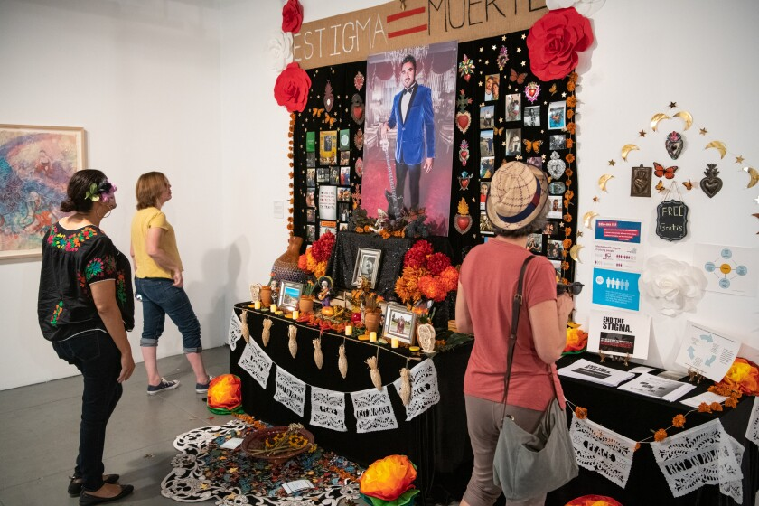 """A Day of the Dead altar, """"Altar for Carlos Zaragoza,"""" at Self Help Graphics & Art's community arts workshop last year."""