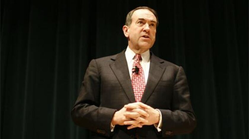 Mike Huckabee, former governor of Arkansas and '08 Republican hopeful, speaks to employees of the Principal Financial Group during a campaign stop in Des Moines, Iowa.