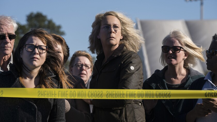 """In """"Halloween,"""" Jamie Lee Curtis (center) returns to her iconic role as Laurie Strode, who comes to"""