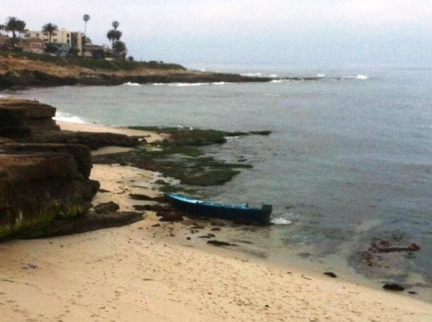Several people came ashore in La Jolla Friday morning from a panga that landed on a beach just south of the Children's Pool.