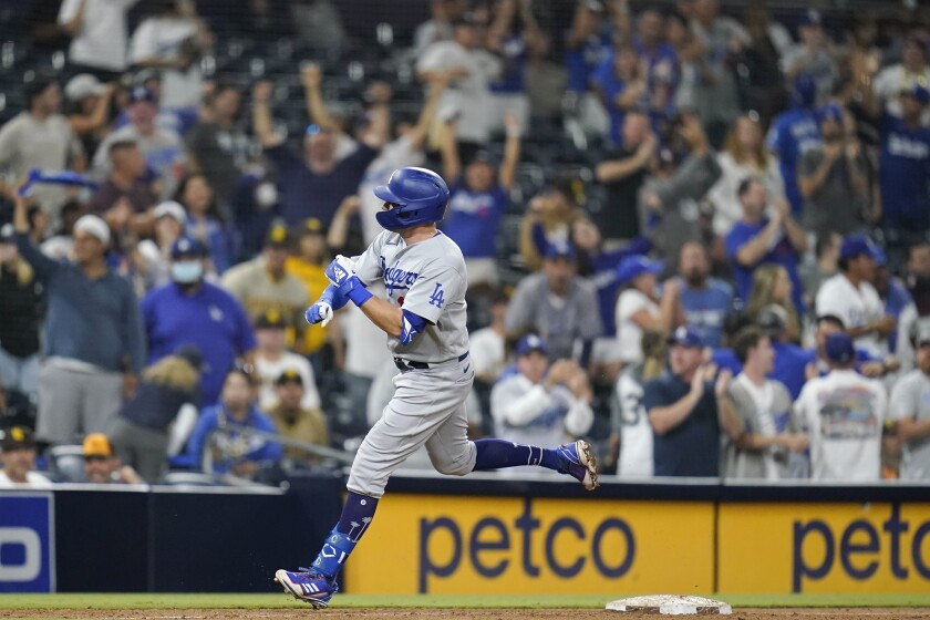 The Dodgers' AJ Pollock rounds the bases after hitting a two-run homer in the 16th inning against the Padres