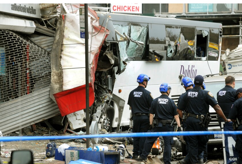 FILE: Rescuers at the scene of Flushing bus crash that killed one and injured at least 16 people on Northern Blvd at Main Street