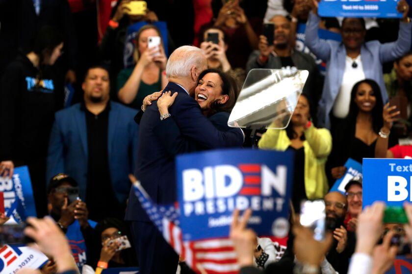 Sen. Kamala Harris hugs former Vice President Joe Biden at a March 9 campaign rally in Detroit.