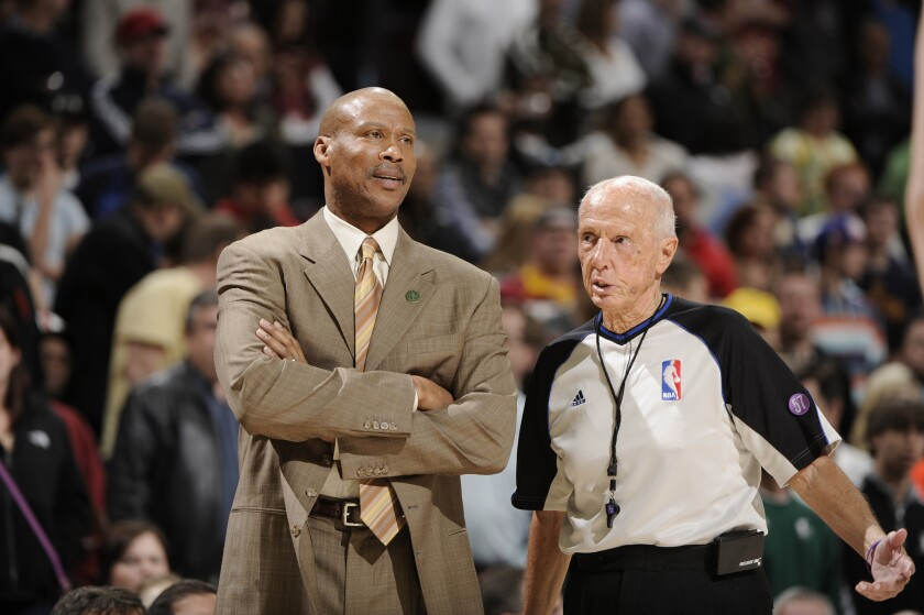 Byron Scott stands on the court as his Cleveland Cavaliers take on the Detroit Pistons in Cleveland in April 2013.
