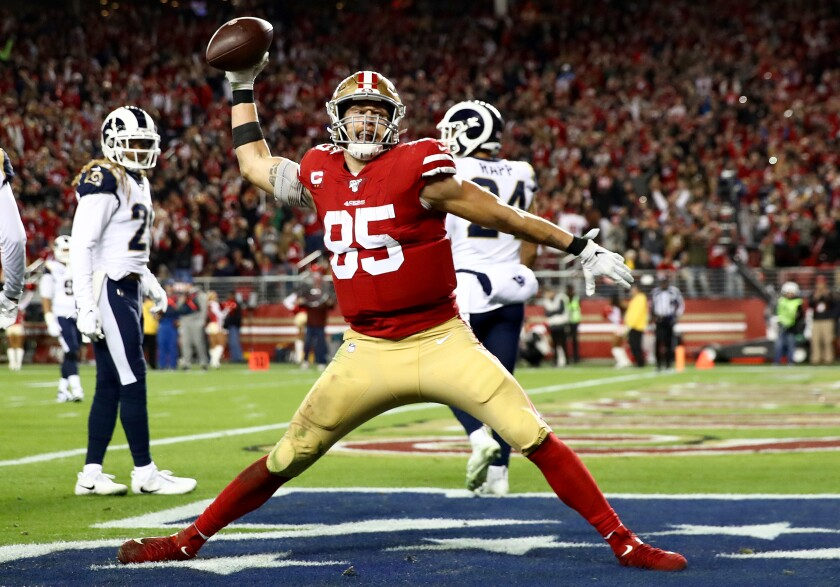 Tight end George Kittle spikes the ball after scoring a touchdown against the Rams on Dec. 21 at Levi's Stadium.