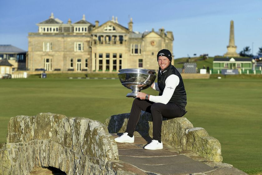 England's Danny Willett poses with the trophy after winning the Alfred Dunhill Links Championship at St Andrews, Scotland, Sunday Oct. 3, 2021. (Malcolm Mackenzie/PA via AP)