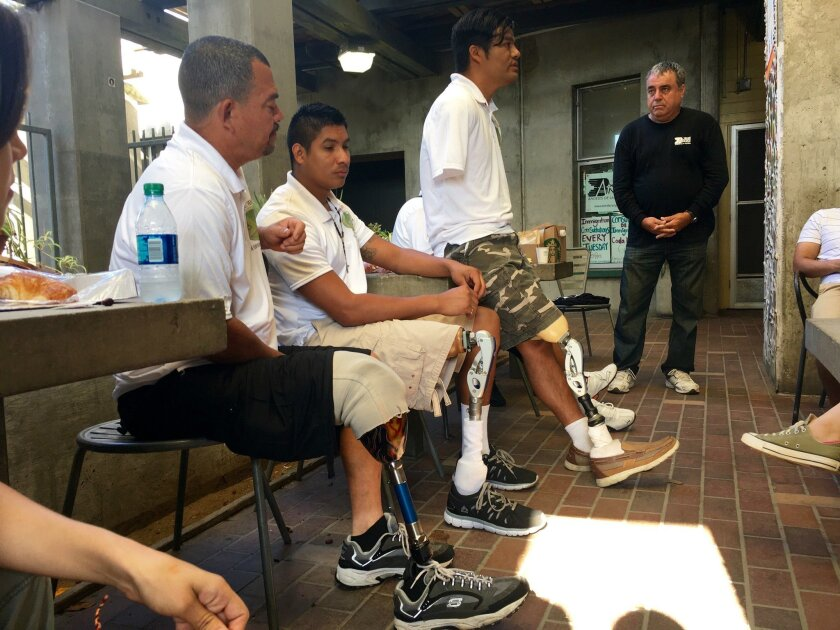 """Honduran migrants, all victims of """"La Bestia,"""" spoke about their experiences at the organization Border Angels on June 27."""