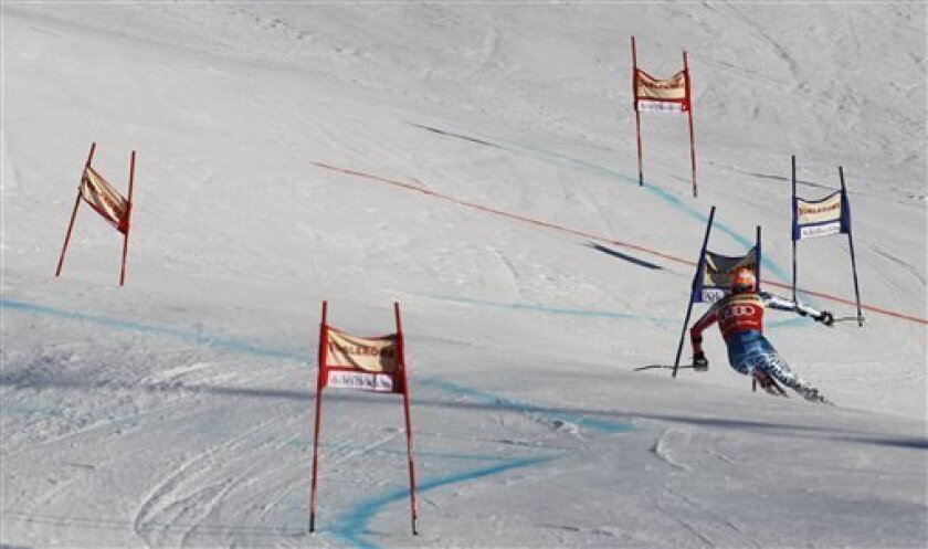 Ted Ligety, of the U.S., speeds down the course during the first run of an alpine ski, men's World Cup giant slalom in Adelboden, Switzerland, Saturday, Jan. 8, 2011. (AP Photo/Alessandro Trovati)